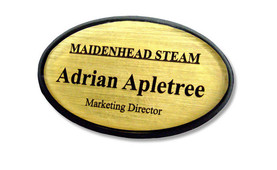 Shaped plastic name badges - Black border and brushed gold background | www.namebadgesinternational.ie
